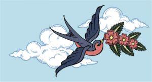 空を飛んでいるツバメ